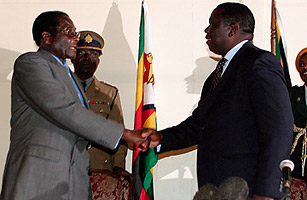 The handshake between Mugabe and Tsvangirai