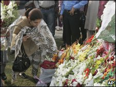 Mourners lay wreaths at the site
